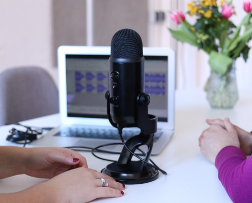 women doing a podcast interview