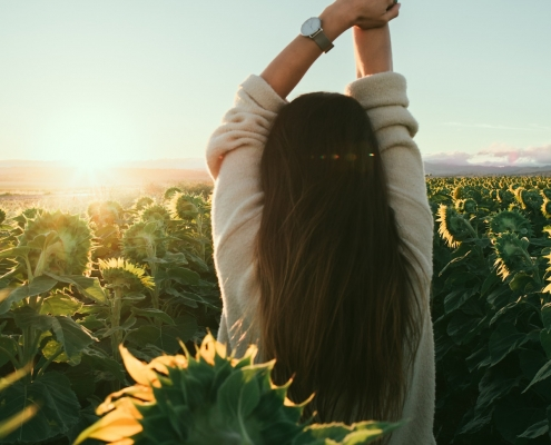 Woman in sunflower flied