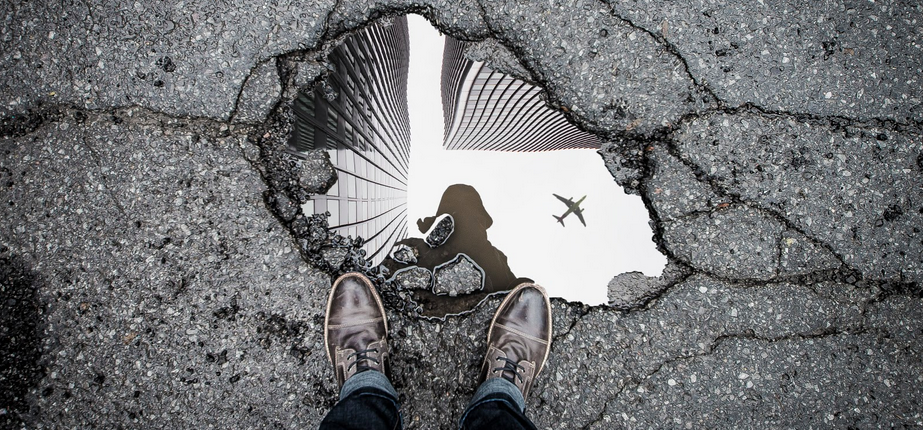airplane reflection in a puddle